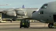 American aid begins to reach Tacloban Cebu Royal Air Force military aircraft taxiing on runway