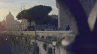 Typical glimpse of Rome from Tiber river bridge