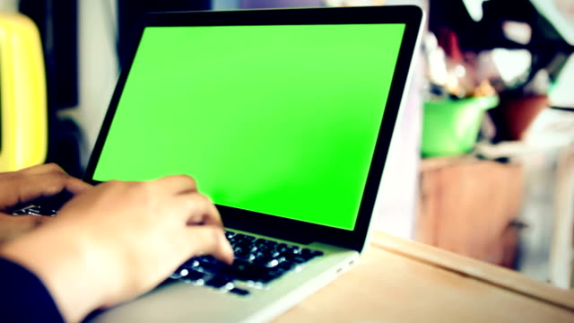 Typing On Notebook Computer With Green Screen