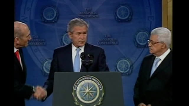 Tzipi Livni calls for new election after failure to form coalition government T27110708 Maryland Annapolis INT George W Bush shakes hands with Ehud...