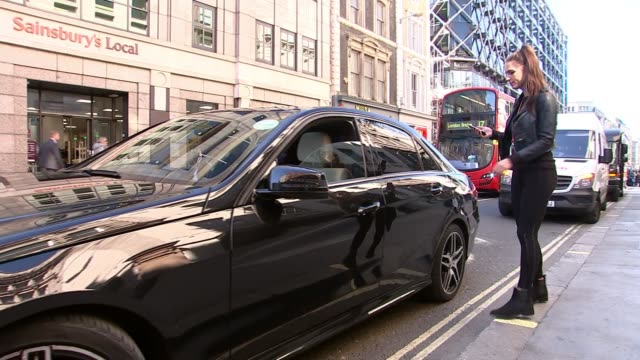 Online petition opposing tops half a million signatures Woman getting in Uber car