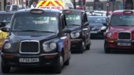 Uber loses licence to operate in London ENGLAND London EXT Various shots of traffic along street People unloading bags from car boot Black cabs along...