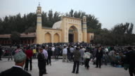 Uighur Muslims gather at Id Kah Mosque for prayer