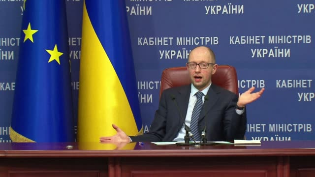 Ukraines parliament on Thursday confirmed pro Western Arseniy Yatsenyuk as premier to lead a new coalition government while fresh attacks in the east...