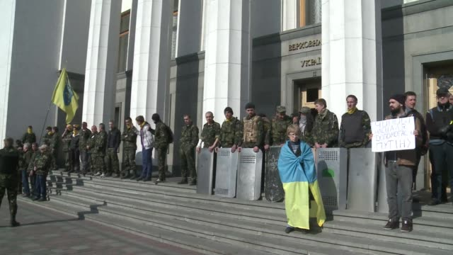 Ukrainian far right nationalists rallied outside the parliament building in Kiev for a second day Friday days after police shot dead one of their...