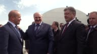 Ukrainian President Petro Poroshenko Belarussian President Alexander Lukashenko and Director of the Chernobyl nuclear power plant Igor Gramotkin in...