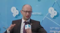 Ukrainian Prime Minister Arseniy Yatsenyuk on Saturday urged the West not to lift sanctions on Russia for its role in the Ukraine conflict unless the...