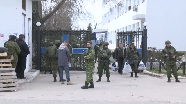 Ukrainian soldiers filed out of navy headquarters in Sevastopol on Wednesday after it was seized by hundreds of pro Moscow activists and Russian...