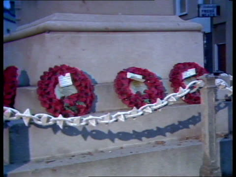 Enniskillen IRA bomb NORTHERN IRELAND Ulster Co Fermanagh Enniskillen Statue of soldier in mourning at top of war memorial Union Jack PULL OUT MS...