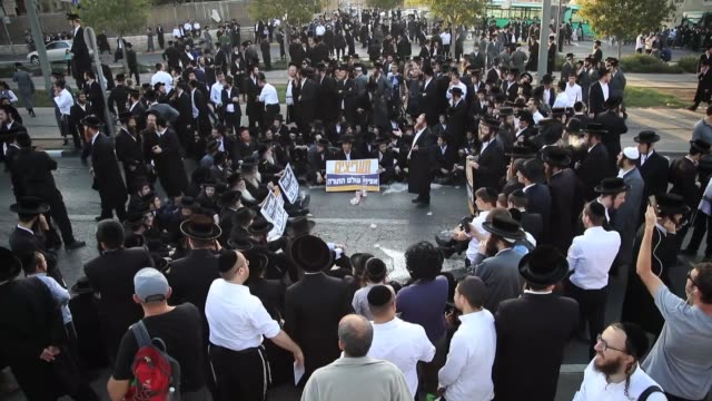 UltraOrthodox Jewish demonstrators block a main road in Jerusalem during a protest against Israeli army conscription on October 23 2017 Many...