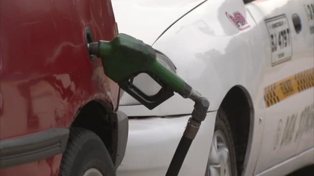 CU Unattended gas pump in car's gas tank / near San Cristobal, Tachira, Venezuela