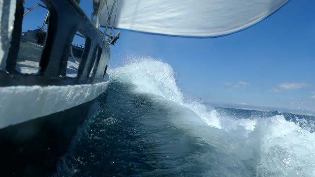 Under the sails of a racing yacht in a storm