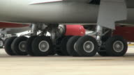 CU PAN Undercarriage of passenger jet taxing, London, United Kingdom