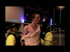 Undercover night shots police officers arresting rowdy drunk people in streets