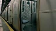 USA underground station. Train moving towards camera