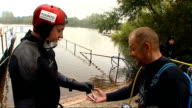 Middlesex Wraysbury Dive Centre EXT Chris Sirett and Mark Bruce talking as dividing up ration packs for underwater bicycle ride SOT Sirett and Bruce...