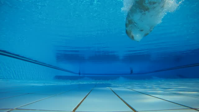 HD SLOW MOTION: Underwater Shot Of Jumping Into Pool