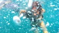 underwater shot of woman swimming