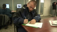 CU ZO MS Unemployed worker filling out paperwork and applications at Michigan Works job center, Jackson, Michigan, USA