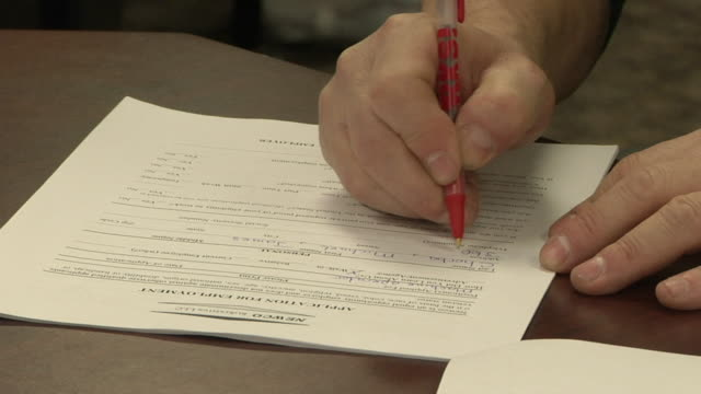 ZI CU Unemployed worker fills out paperwork and applications at Michigan Works job center, Jackson, Michigan, USA