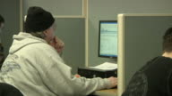 ZI CU Unemployed worker using computer at Michigan Works job center, Jackson, Michigan, USA
