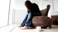 Unhappy single woman sits alone