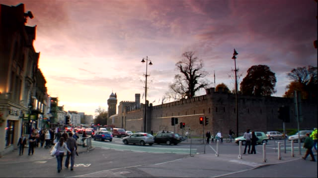 Unidentifiable people traffic on crowded Cardiff city centre street Cardiff Castle BG UK