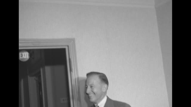 Unidentified man in hallway of Commodore Hotel in New York City / Note documentation incomplete