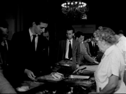 Unidentified upperclass dormitory building students in line w/ trays being served food in dorm House serving line VS Communal tables dining room...
