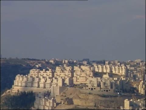 Uniform stone buildings cover a hilltop in Bethlehem.