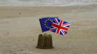 Union and EU Flags In Sandcastle