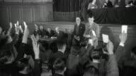 1955 MONTAGE Union members participate in a vote / United Kingdom