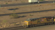 MS AERIAL ZO TS Union Pacific freight train moving along tracks / Arizona, United States