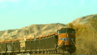 A Union Pacific freight train speeds through the California desert.