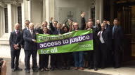 Unison union members cheering outside the Supreme Court after workers fees for bringing claims to employment tribunals were abolished