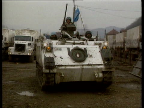 United Nations attempts to get convoy of humanitarian supplies through to besieged Srebrenica / Stationary United Nations aid convoy of trucks /...