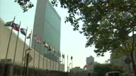 CLEAN United Nations Headquarters building exteriors UN members flags inc United Nation flag blowing in the wind United Nations Headquarters...