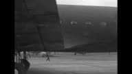 United States Army Air Force Douglas C54 transport plane taxis to stop / CU Army emblem on side / Secretary of State Cordell Hull wife Rose at...