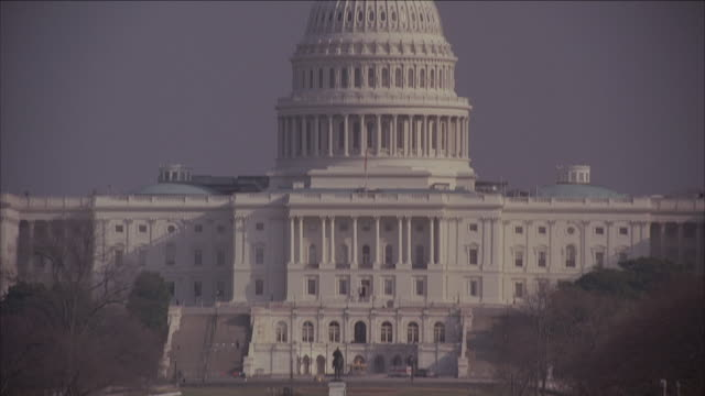 TU United States Capitol building set against a clear blue sky / Washington D.C.