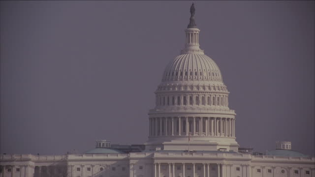 PAN United States Capitol building set against a gray sky / Washington D.C.