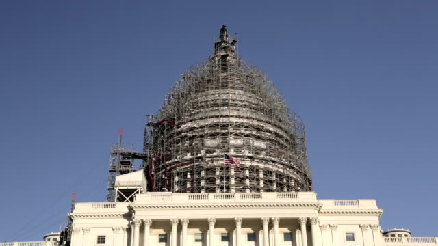 United States Capitol Dome Under Renovation Tilt Up with American Flag