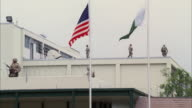 WS United States Embassy building in Middle East country with Armed troops patrol on roof / Pakistan