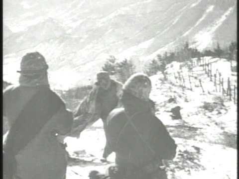 United States Marines 1st Division 7th Division soldiers capturing Chinese Communist soldiers on top of snowy hill VS Chinese prisoners of war...