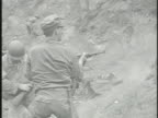 United States Marines firing rifles into enemy holes flushing MS SEMIGRAPHIC Deceased North Korean soldiers in dirt VS North Korean soldiers...