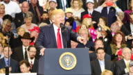United States President Donald Trump closes his speech after he speaks to 15000 of his supporters during a campaign rally style stop at Freedom Hall...