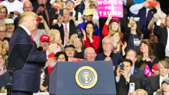 United States President Donald Trump greets his supporters and waves to them after speaking to 15000 of his supporters about repealing and replacing...