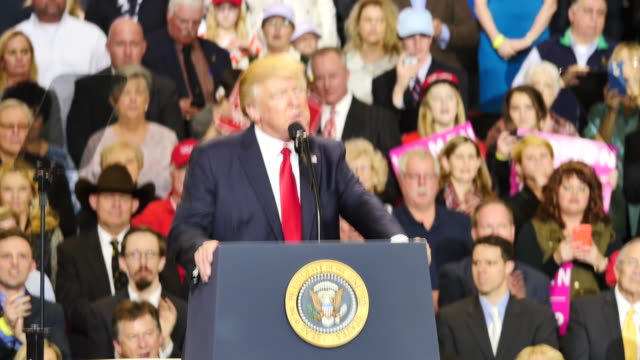 United States President Donald Trump speaks to 15000 of his supporters about taxes and draining the swamp during a massive campaign rally style stop...