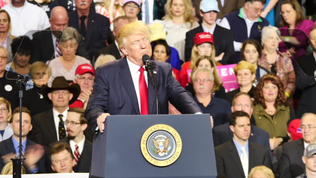 United States President Donald Trump speaks to 15000 of his supporters about patriotism the American flag and Colin Kaepernick during a massive...
