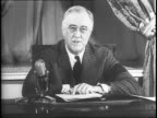 United States President Franklin D Roosevelt delivering a speech from his office about the war effort