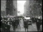 An aviator enjoys a massive ticker tape parade in New York City